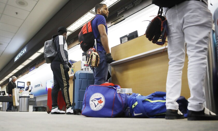 Steward Berroa, center, and teammates from the Dominican Republic at Tampa International Airport.