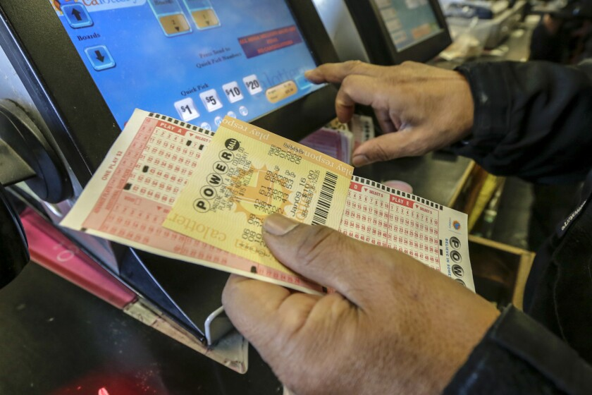 Customers buy Powerball lottery tickets at Bluebird Liquor store in Hawthorne.