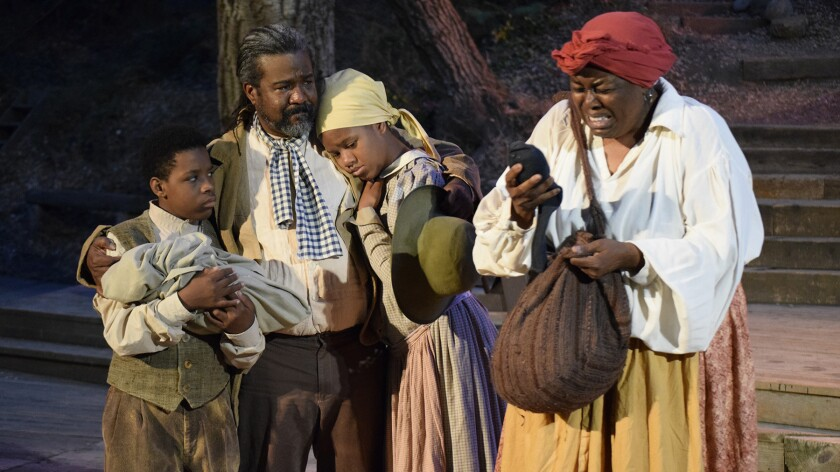 Uncle Tom (Gerald C. Rivers, second from left) comforts family members torn asunder by the horrors of slavery depicted in Harriet Beecher Stowe's classic novel. Cast members, from left, Charis Holloman, Jasmine Nicole Jacquet and Earnestine Phillips.