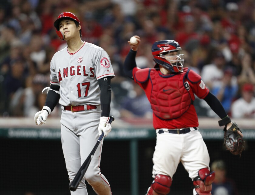 Angels' Shohei Ohtani reacts after striking out in the eighth inning against the Indians on Friday in Cleveland.
