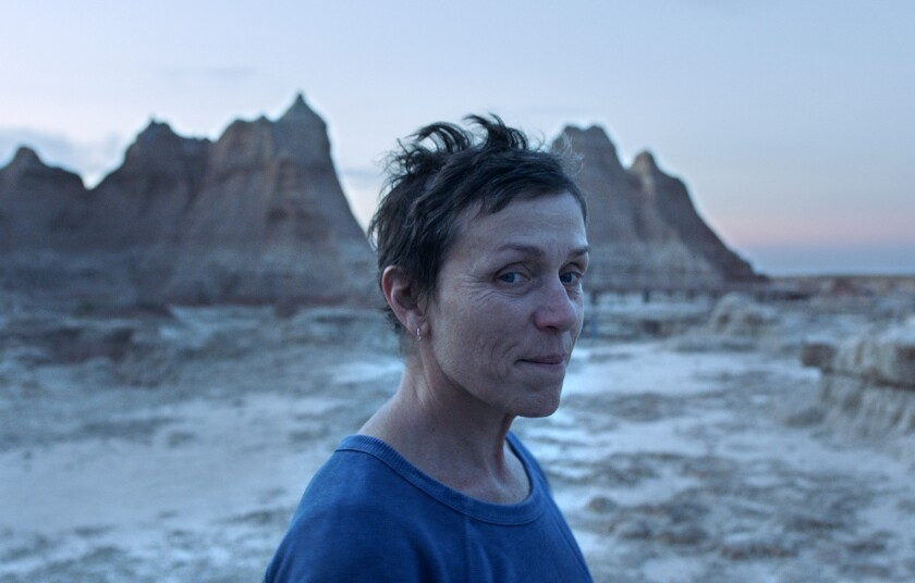 """This image released by Searchlight Pictures shows Frances McDormand in a scene from the film """"Nomadland"""" by Chloe Zhao. The film won best feature at the Gotham Awards on Monday, Jan. 11, 2021. (Searchlight Pictures via AP)"""