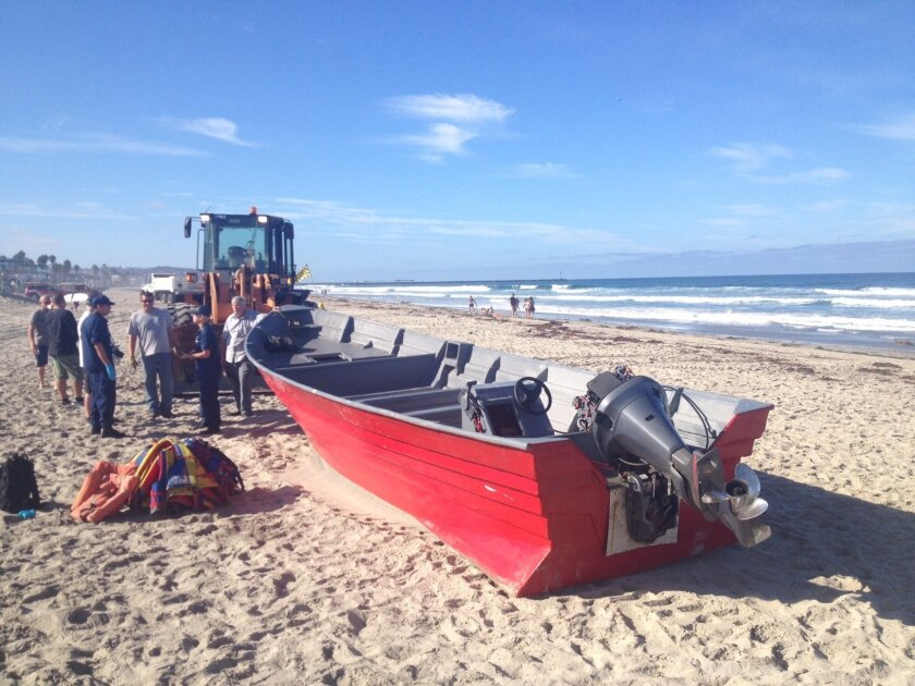 Dozens of people fled from a Panga boat that washed ashore in Mission Beach.
