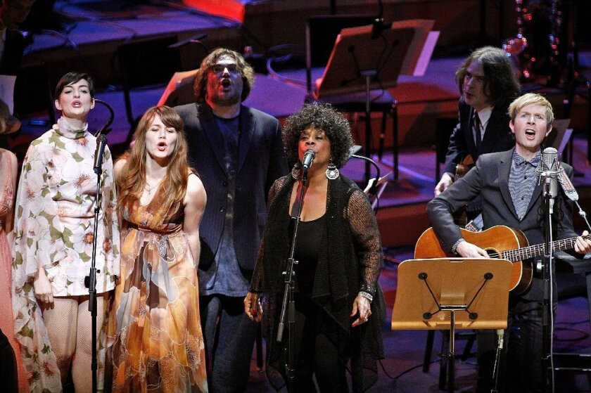 """Beck, far right, performs with special guests including Anne Hathaway, left, Jenny Lewis, Jack Black, Merry Clayton and Jon Brion during his """"Song Reader"""" project at Disney Hall in downtown Los Angeles on Sunday."""