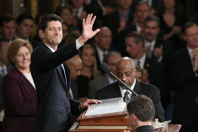 Newly sworn-in Speaker of the House Paul Ryan waves to colleagues after his election to the leadership position on Oct. 29.