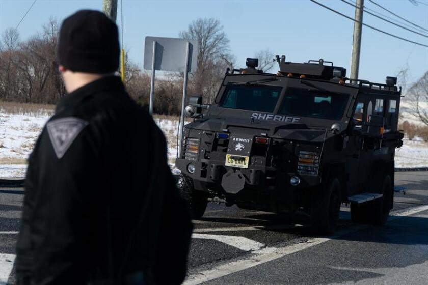 Police reinforcements arrive outside an office of the UPS company in New Jersey, United States, Monday Jan. 14, 2019. EPA-EFE/Michael Candelori