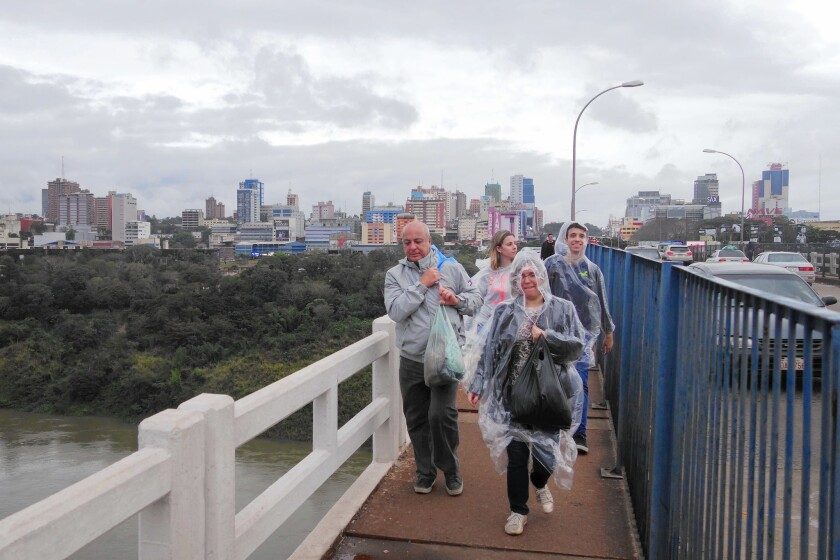 Shoppers cross back into Brazil from Paraguay over the Friendship Bridge between Foz do Iguacu and Ciudad del Este.