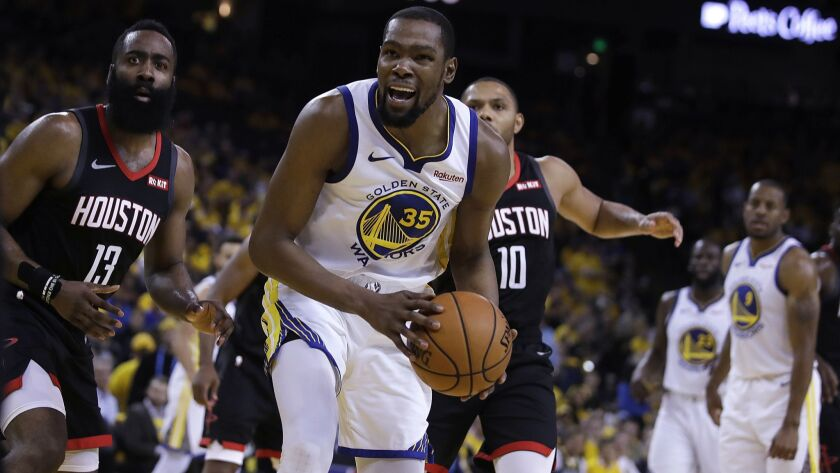 Houston Rockets' James Harden, left, and Golden State Warriors' Kevin Durant (35) react to a referee's call during the second half of Game 5 of a second-round NBA playoff series on Wednesday in Oakland.