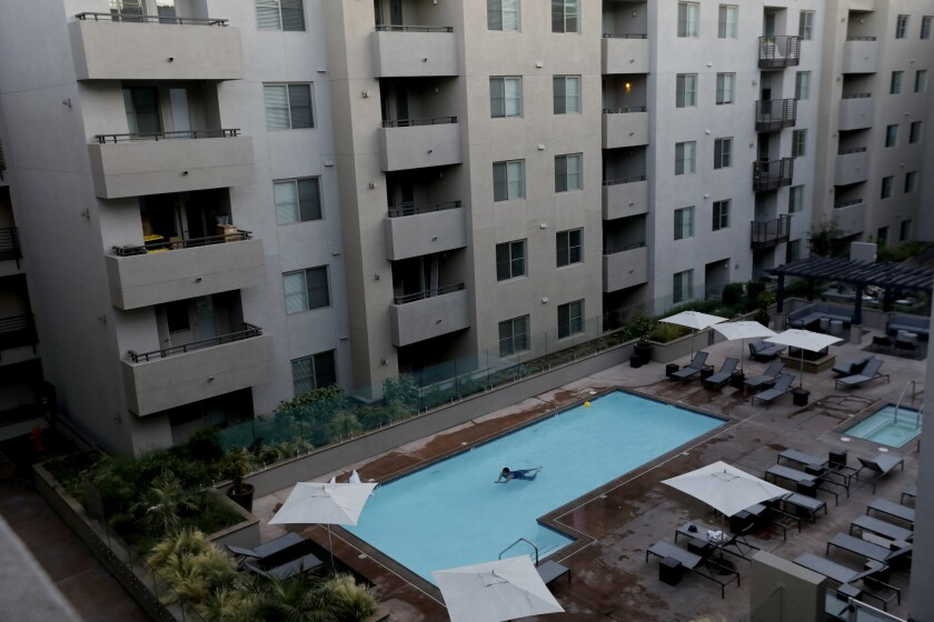The pool and courtyard at an apartment building on Highland Avenue in Hollywood that includes short-term rentals is shown in mid-July.