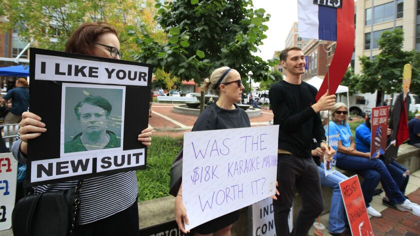 Protesters are gathered in front of the Alexandria Federal Court in Alexandria, Va., Tuesday, July 3