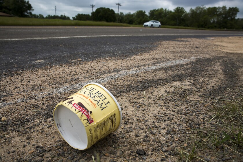 A Blue Bell ice cream container lies abandoned on the side of a highway in Brenham, Texas, on April 23.