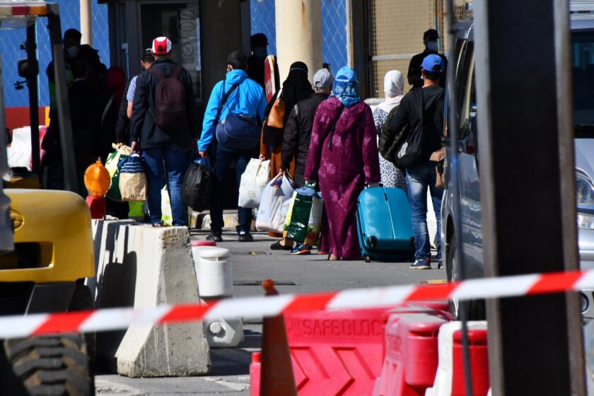 In this Friday photo, Moroccan citizens wait for repatriation after being stranded in Spain because of the coronavirus pandemic in the Spanish enclave of Ceuta, Spain.