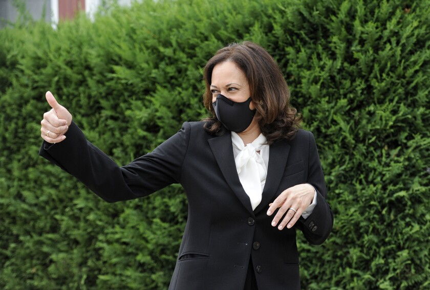 In this Sept. 17, 2020, photo, Democratic vice presidential candidate Sen. Kamala Harris, D-Calif., gives a thumps up during a campaign stop in Philadelphia. Black voters across Michigan will be pivotal in deciding who will win the battleground state in November. But engaging them at a time of immense uncertainty across the nation because of the pandemic and unrest over the effects of systemic racism has been especially challenging. (AP Photo/Michael Perez)