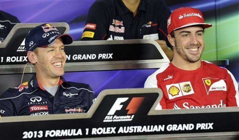 Red Bull driver Sebastian Vettel of Germany, left, and Ferrari driver Fernando Alonso of Spain laugh during a press conference ahead of the Australian Formula One Grand Prix at Albert Park in Melbourne, Australia, Thursday, March 14, 2013. (AP Photo/Andrew Brownbill)