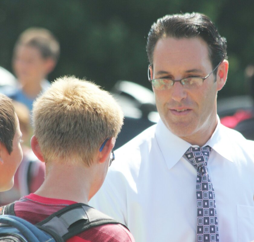 Muirlands Middle School Principal Harlan Klein speaks with a student after classes Sept. 10.