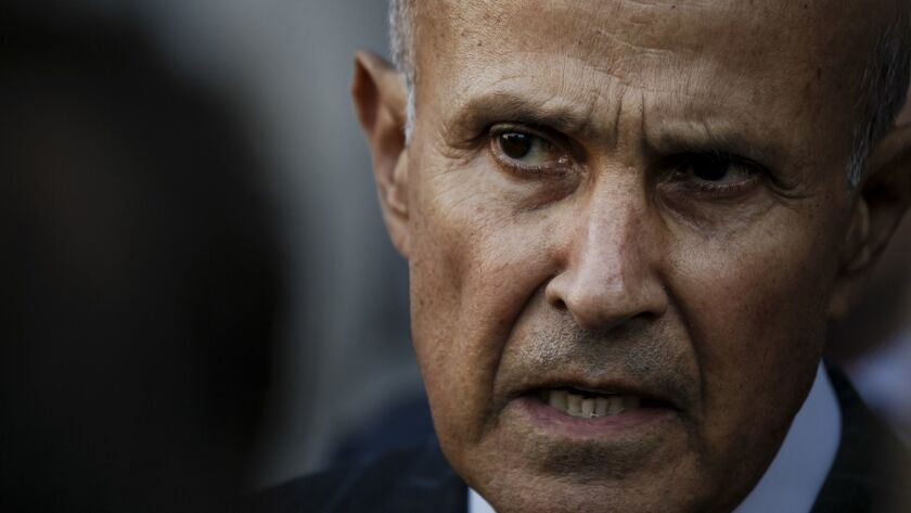 Former Los Angeles County Sheriff Lee Baca talks to reporters outside the federal courthouse after his first trial ended in mistrial in 2016.