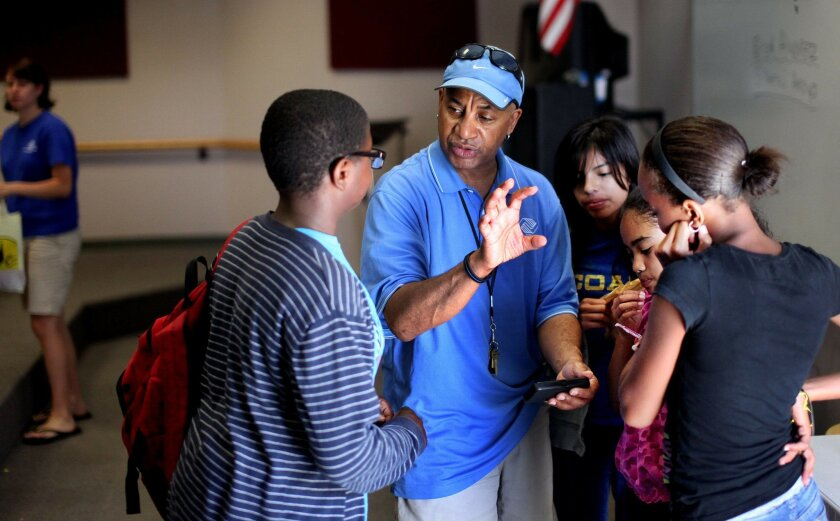 Mentor J Dub Williams chats with students during a mentoring program for military kids at Martin Luther King Middle School in Oceanside on Thursday, May 17, 2012.(Photo by Sandy Huffaker)
