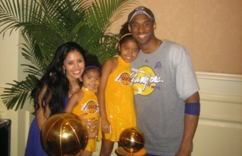 Kobe Bryant and his family posed with the Larry O'Brien Championship Trophy and MVP Award in June 2009.