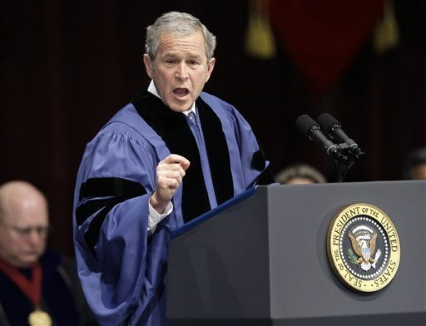 President George W. Bush speaks during a commencement ceremony at Texas A&M University, Friday, Dec. 12, 2008, in College Station, Texas. (AP Photo/David J. Phillip)