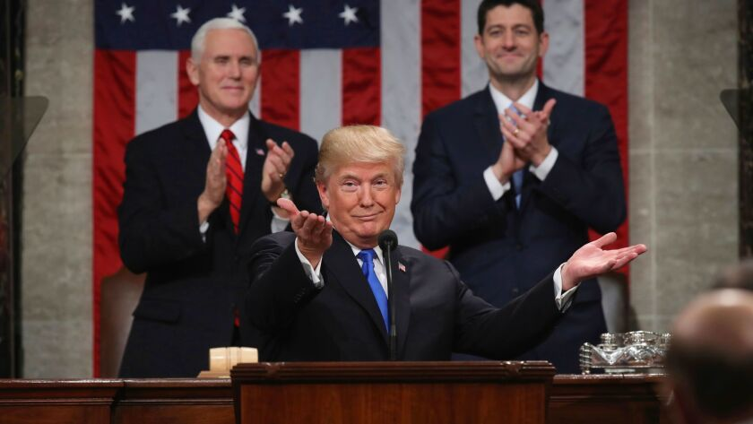 President Donald Trump gestures as delivers his first State of the Union address in the House chambe