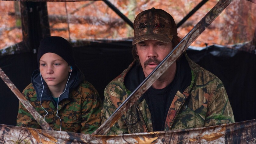 "Montana Jordan and Josh Brolin in a scene from the film ""The Legacy of The Whitetail Deer Hunter."""