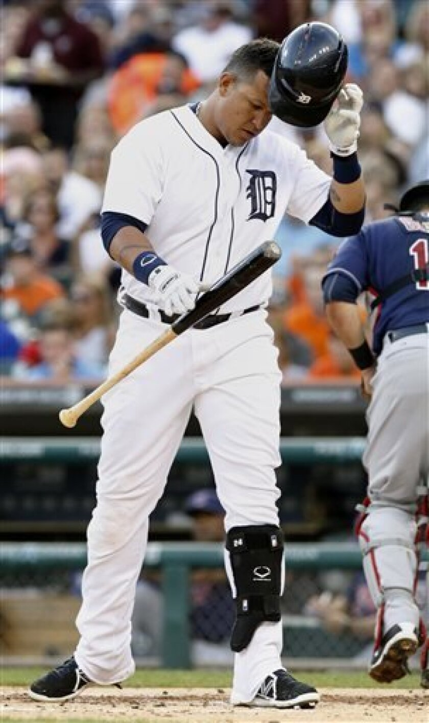 Detroit Tigers' Miguel Cabrera drops his bat and helmet after striking out against Cleveland Indians starting pitcher Zach McAllister in the first inning of a baseball game, Friday, Aug. 30, 2013, in Detroit. Cabrera was pulled from the game after two innings. The Tigers defeated the Indians 7-2 in