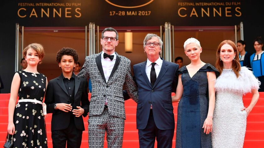 """At the Cannes' """"Wonderstruck"""" screening, from left, actress Millicent Simmonds, actor Jaden Michael, writer/screenwriter Brian Selznick, director Todd Haynes, actress Michelle Williams and actress Julianne Moore on May 18, 2017."""