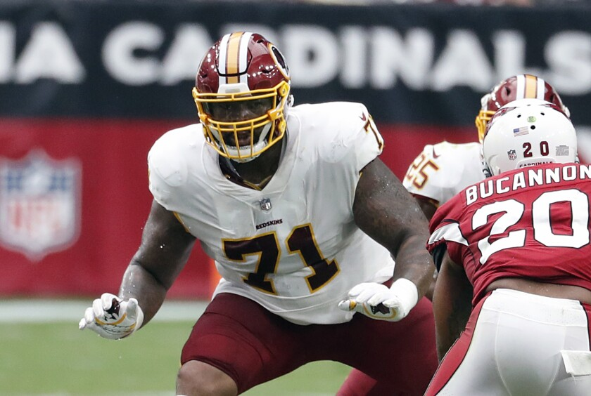FILE - In this Sept. 9, 2018, file photo, Washington Redskins offensive tackle Trent Williams (71) crouches during an NFL football game against the Arizona Cardinals in Glendale, Ariz. After years of playing in a dysfunctional organization in Washington, the difference in the vibe of a winning franchise hit Williams as soon as he walked into the building for the San Francisco 49ers' training camp. (AP Photo/Rick Scuteri, File)