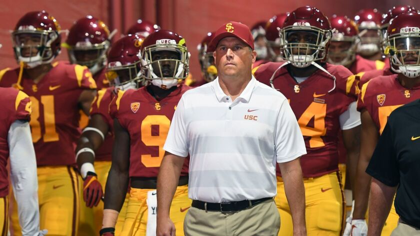 LOS ANGELES, CALIFORNIA SEPTEMBER 1, 2018-USC head coach Clay Helton leads his team on to the field