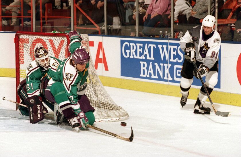 Wayne Gretzky, shown in a 1996 game between the Kings and Anaheim, could cause trouble for the Ducks in a simulated game on Friday.