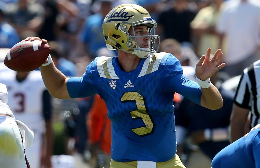 UCLA quarterback Josh Rosen passes downfield against Virginia in the first half Saturday at the Rose Bowl.