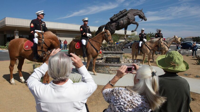 Reckless, a hero horse for the Marines, is honored with a statue at Camp Pendleton. The mounted color guard is from the Marine base in Barstow.