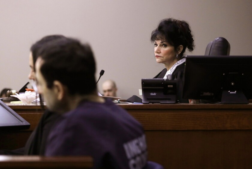 Judge Rosemarie Aquilina looks towards Larry Nassar as a victim gives her impact statement during the seventh day of Larry Nassar's sentencing hearing Wednesday, Jan. 24, 2018, in Lansing, Mich.