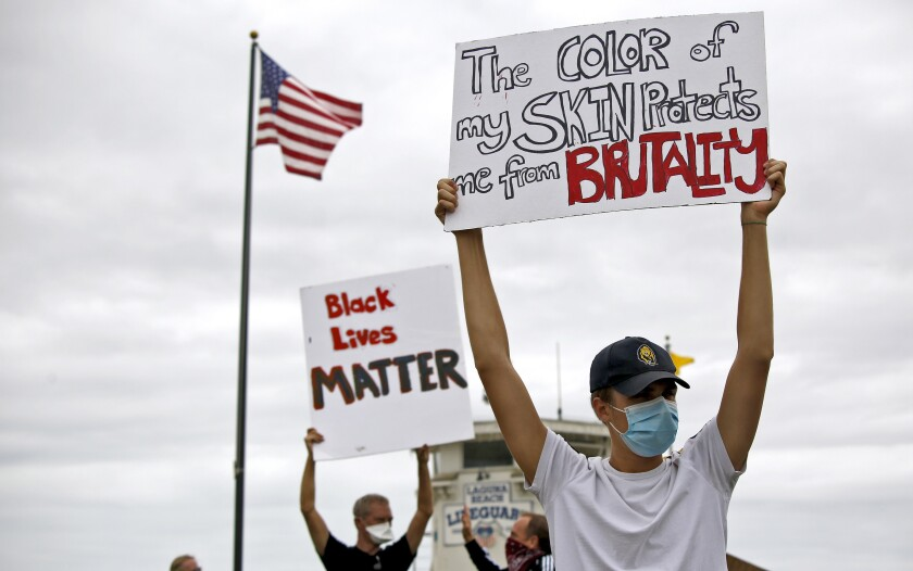Dozens of Black Lives Matter protesters held signs and chanted at Main Beach Park.