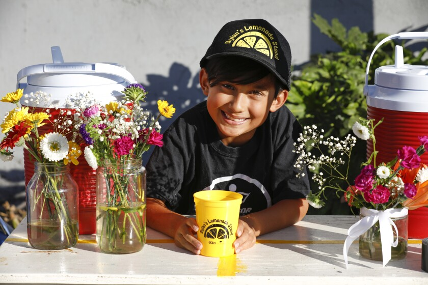 Dylan Rodrigues at his lemonade stand on Wednesday in Ocean Beach.