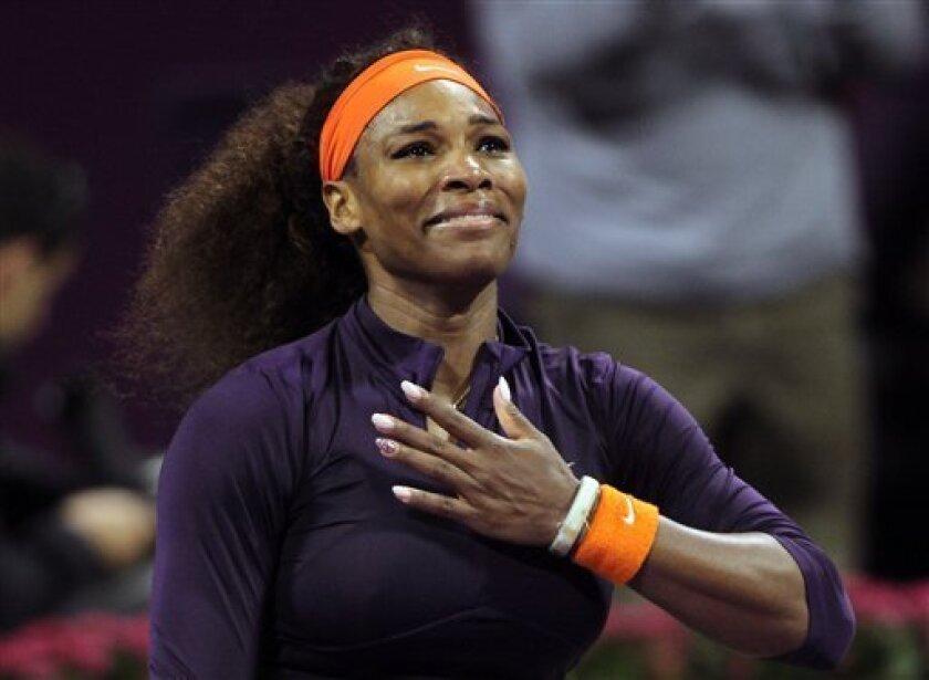 Serena Williams of the U.S. celebrates after winning against Czech Republic's Petra Kvitova in their WTA Qatar Ladies Open tennis quarterfinal match in Doha, Qatar, Friday, Feb. 15, 2013. (AP Photo/Osama Faisal)