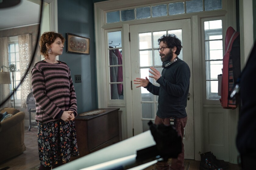 """Kaufman directing Buckley on the set of """"I'm Thinking of Ending Things."""""""