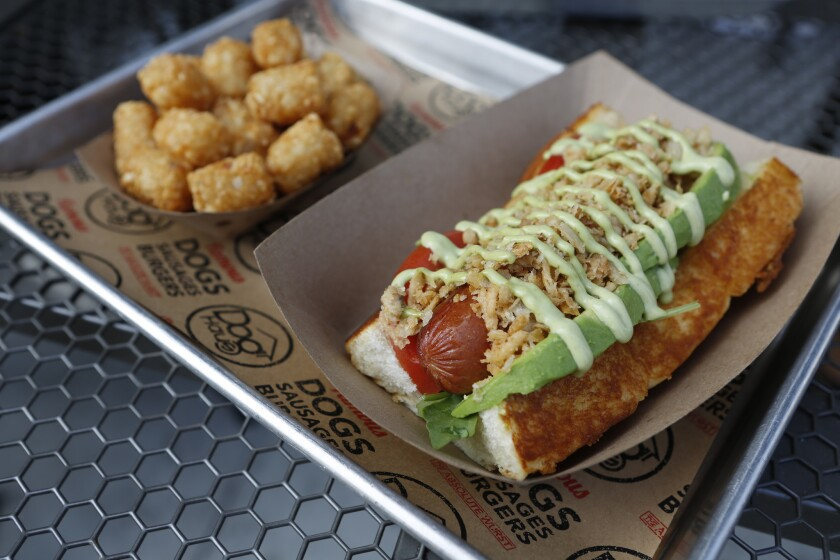 Dog Haus signed a deal enabling it to expand from 21 locations to nearly 500 in the next seven years. Above, its Sooo Cali hot dog, with wild arugula, basil aioli, avocado and tomato.