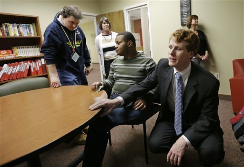 U.S. Rep. Joseph Kennedy III, D-Mass., greets people in the lounge of the Seven Hills Foundation's new facility in Milford, Mass., Monday, Feb. 11, 2013. Seven Hills features the ASPIRE! program for people with developmental disabilities.  Kennedy is the grandson of former Attorney General Robert F