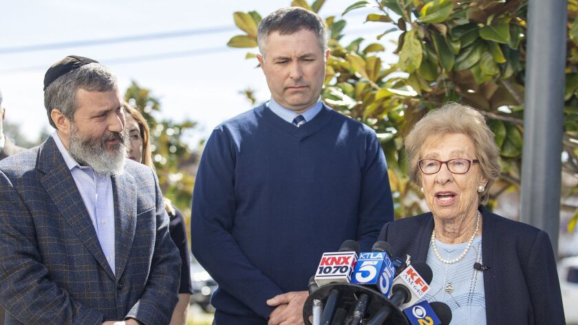 Eva Schloss, 89, a Holocaust survivor and Anne Frank's stepsister, is flanked by Newport Harbor High