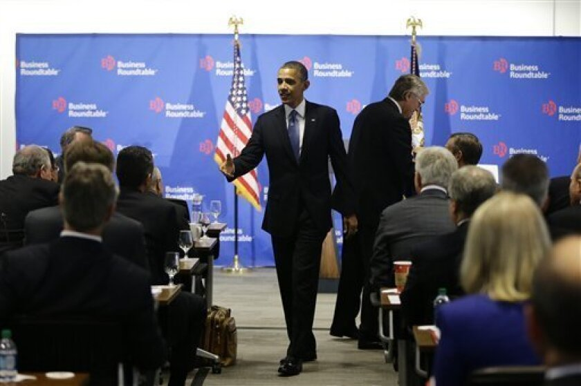 President Barack Obama walks over to shake hands with business leaders before speaking about the fiscal cliff during an address before the Business Roundtable, an association of chief executive officers, Wednesday, Dec. 5, 2012, in Washington. (AP Photo/Charles Dharapak)