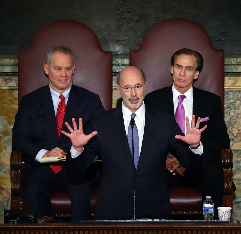 Gov. Tom Wolf, center, delivers his budget address for the 2016-17 fiscal year to a joint session of the Pennsylvania House and Senate, as the speaker of the state House of Representatives, state Rep. Mike Turzai, R-Allegheny, left, and Lt. Gov. Mike Stack, right, listen at the State Capitol in Har