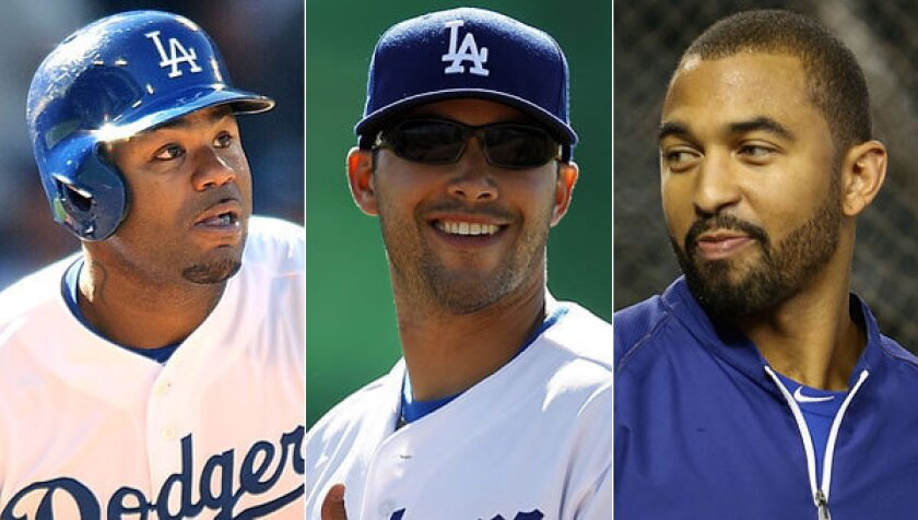 Are any teams interested in acquiring Dodgers outfielders (from left to right) Carl Crawford, Andre Ethier or Matt Kemp? Dodgers General Manager Ned Colletti should find out this week.