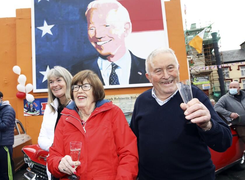 Brendan Blewitt, a cousin of Joe Biden, and his sister Breege Bourke celebrate Saturday in Ballina, Ireland.