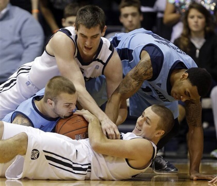 Butler forward Kameron Woods, bottom, fights for a loose ball with teammate Andrew Smith, top left, and Rhode Island forward Mike Aaman, center left, and guard T.J. Buchanan in the first half of an NCAA college basketball game in Indianapolis, Saturday, Feb. 2, 2013. (AP Photo/Michael Conroy)