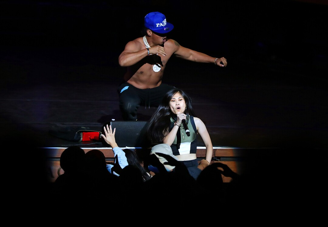 Rappers Ruby Ibarra, below, and Nump perform.