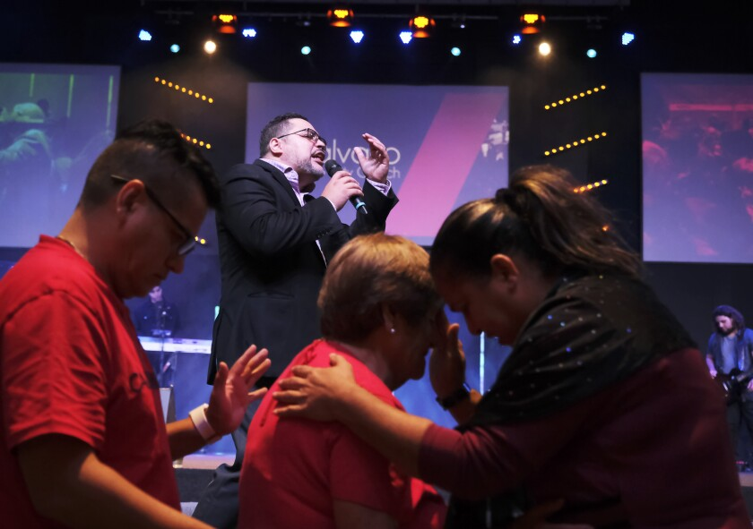 The Rev. Gabriel Salguero preaches at Calvario City Church in Orlando, Fla.