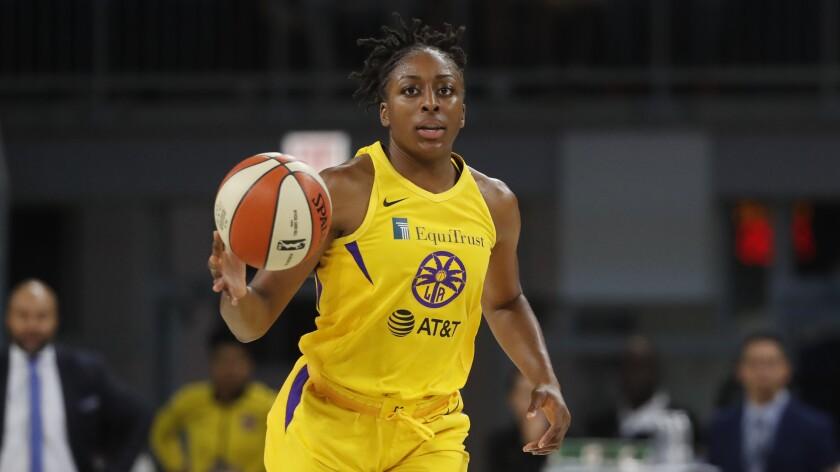 Sparks' Nneka Ogwumike advances the ball.