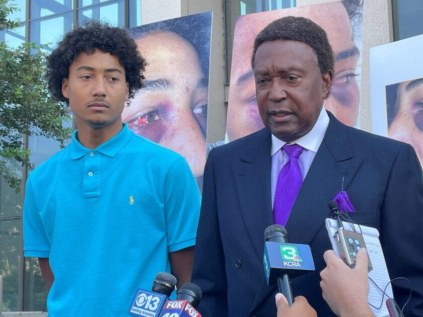 Devin Carter and his lawyer John Burris, right.