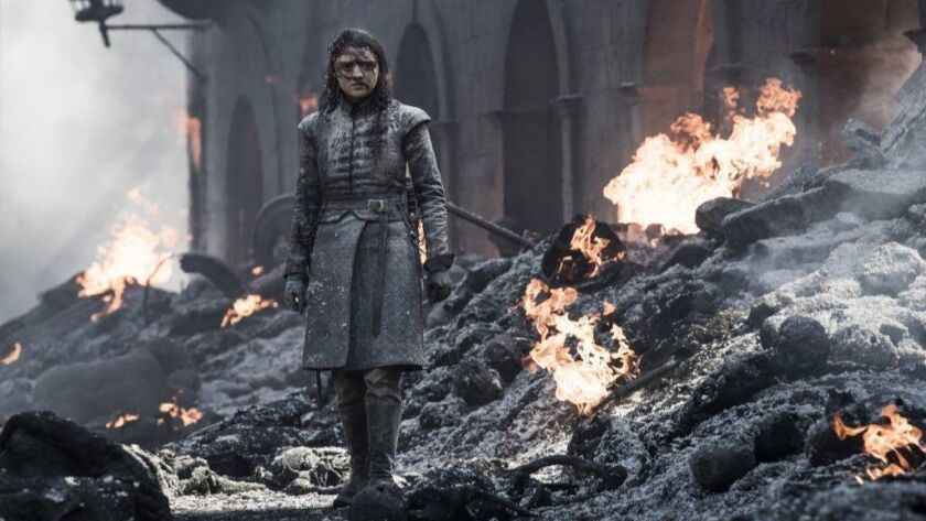 Arya Stark (Maisie Williams) walks in the ashes of King's Landing in 'Game of Thrones'