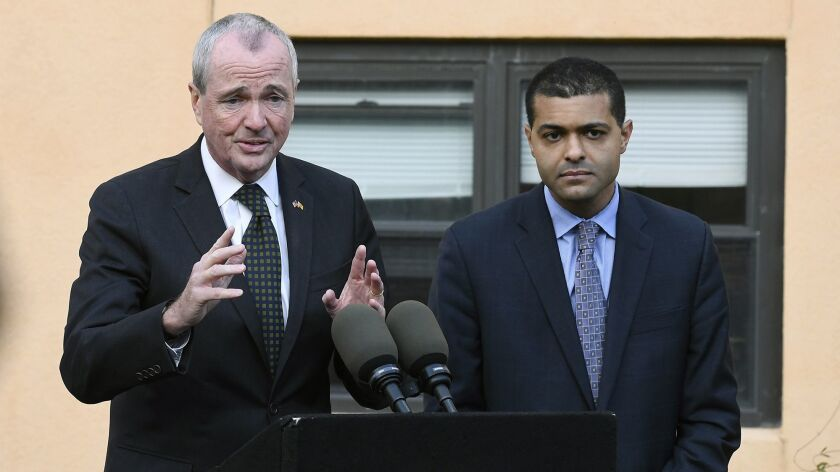 New Jersey Gov. Phil Murphy, left, speaks about a viral outbreak during a news conference with state Health Commissioner Dr. Shereef Elnahal.
